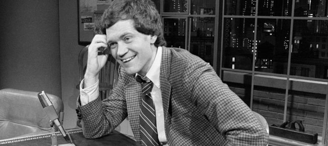 """David Letterman smiles as he hosts the premiere of his talk show on NBC television, """"Late Night With David Letterman"""" in the NBC studios in New York City, New York. (Feb 1, 1982)"""